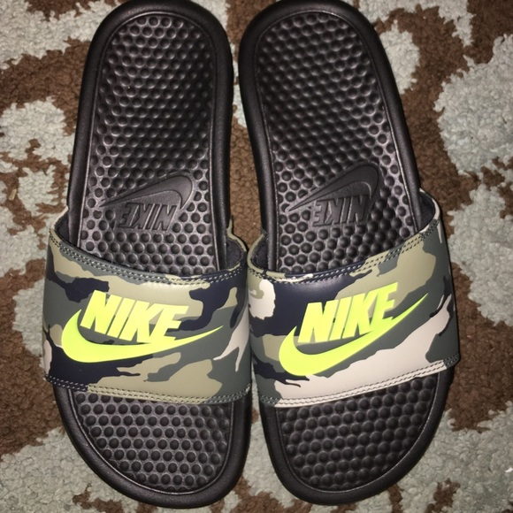 0b7a831352cb Nike camo and neon yellow slides. M 575c87c56a58303842002046