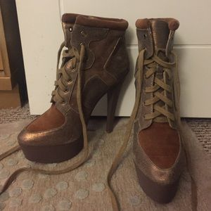 6 inch lace up tan shiny boot heels, lightly worn