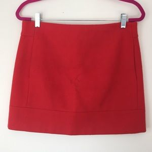 Bright tomato red mini skirt