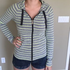 Green and grey zip up