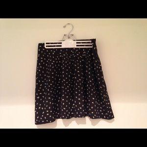 LOFT black skirt with cream feathers print