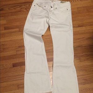 GAP white low rise bootcut jeans.