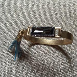 Gold cuff w/ gray rectangle stone & tassels