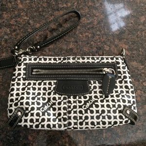 Large black and white Coach wristlet