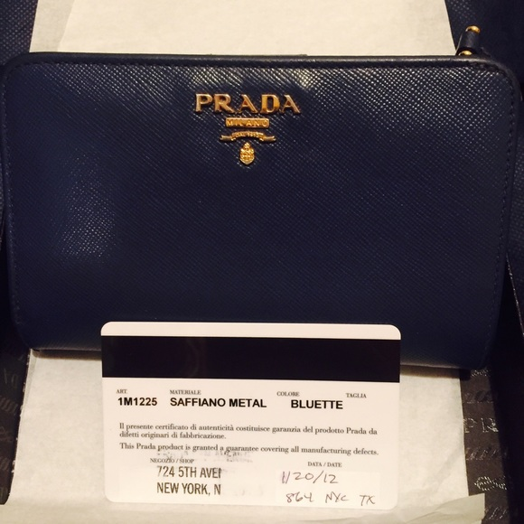 ea9cae854ebd Prada Saffiano Triangle Bi-Fold Tab Wallet. M_576217e97fab3ae887007ede