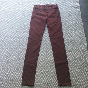 Stretchy maroon skinny jeans