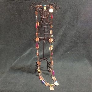Layered beaded and metal disc necklace