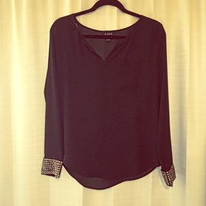 Sheer black long sleeve blouse with gold studs