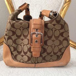 Neutral signature coach bag