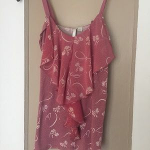 Preowned blouse made by Lauren Conrad . Bow print.