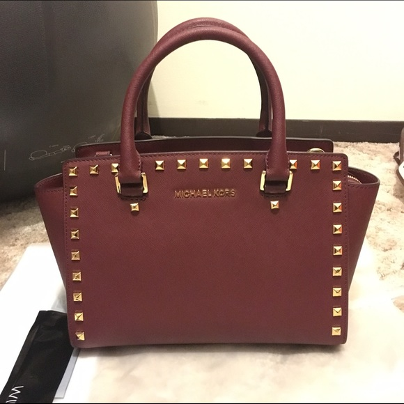 38f654e330b148 MK Selma Stud Medium Top Zip Satchel Color:Merlot.  M_576c02574127d0d444003cb8. Other Bags you may like. Michael Kors ...