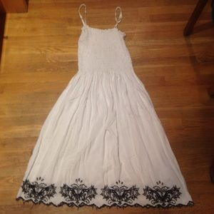 White sun dress with black details.