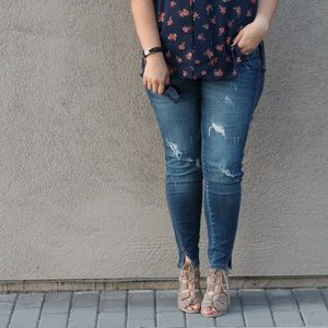 Distressed Skinny Jeans With Notched Ankle