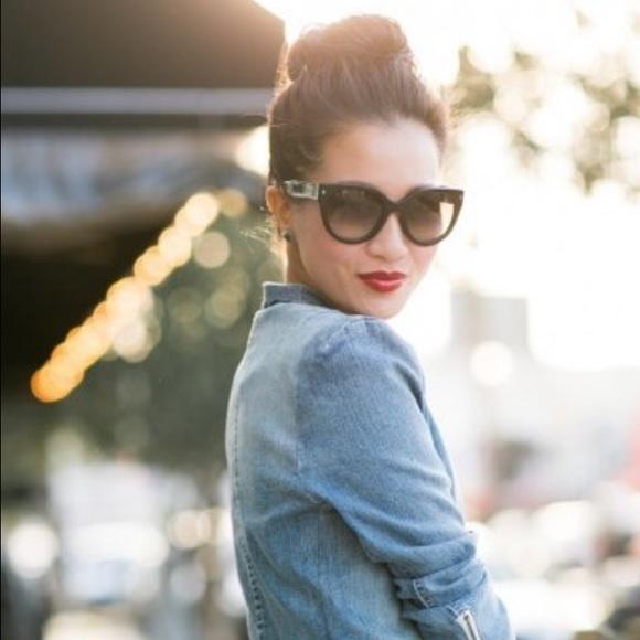 419dc2b046c6 Prada Heritage Cat Sunglasses. M 57705265c28456c0ee00fed8