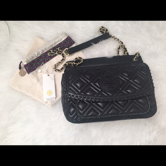 3722ce1a07e4 Tory Burch Marion Quilted Small Shoulder Bag. M 577075b613302ae87e091e57