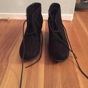Closed toe black wedged booties