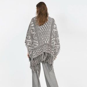 Zara Sweaters - ZARA BLACK AND WHITE FRINGE PONCHO
