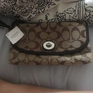Large coach wristlet brand new