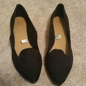 Black suede-like pointed toe flats