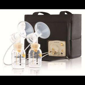 Medela Handbags - Medela Breast pump set comes with bottles and lids