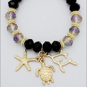 Faceted bead bracelet with charms