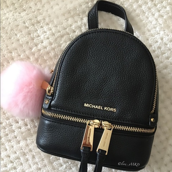 78626e61604dc2 Michael Kors XS Rhea crossbody backpack. M_57725ac9bcd4a79e7c027133