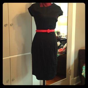 Black pencil dress with assymetrical neckline