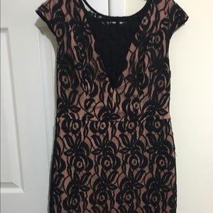 Eva Franco Dresses & Skirts - Black sheer lace dress with sheer V front