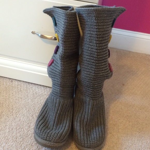 Grey knit uggs with colorful buttons