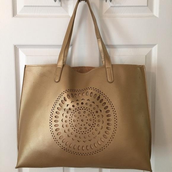 ac76b712d Neiman Marcus Bags | Gold Laser Cut Large Tote Bag | Poshmark