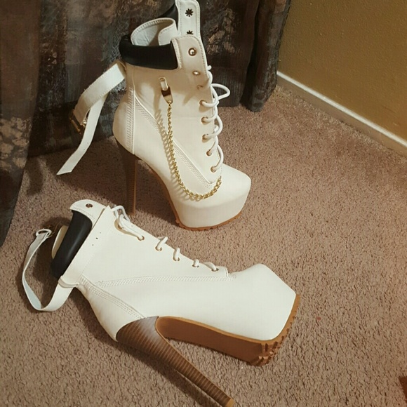 White and brown mock Timberland high heeled boots.  M 5775f91c713fdeeee70347cd f6d45a0a1d83