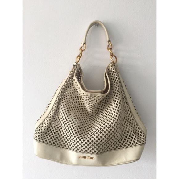 Miu Miu laser cut leather tote bag. M 5776eed898182978160144d8 70e5d240b438e