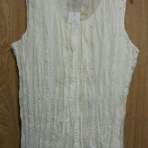 Beautiful 100% silk shell with silk lining.