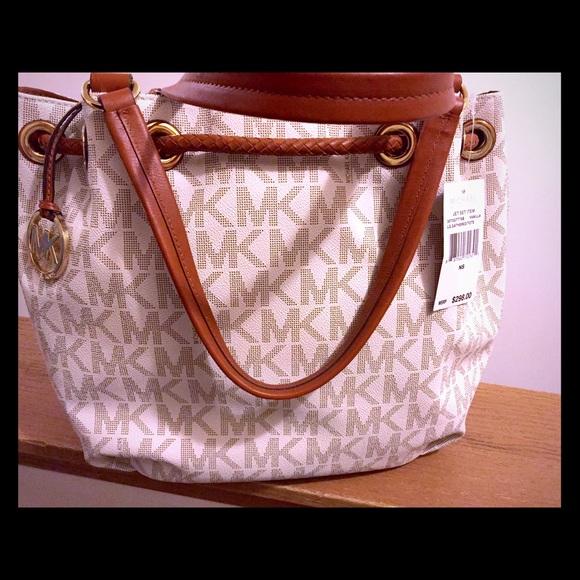 eb5ab37fde20d0 Michael Kors Bags | Jet Set Ns Lg Tote Handbag Vanilla | Poshmark