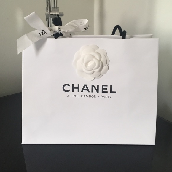 CHANEL - White Chanel shopping bag from Stacy's closet on Poshmark
