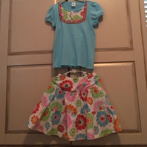 Girls matching top and skirt, size 6. Never worn.