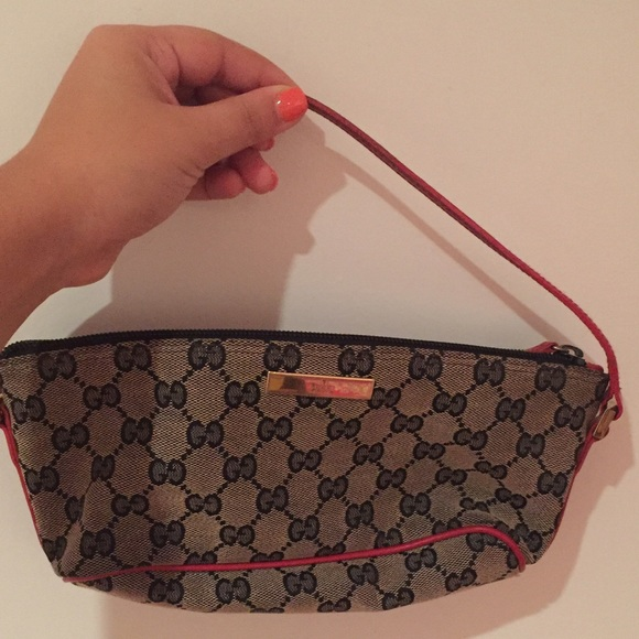 9c9902f2e9be Gucci Handbags - Authentic Gucci red strap logo pochette handbag!