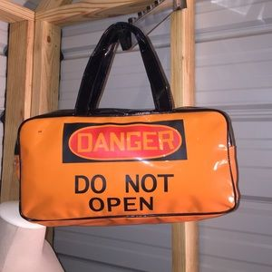 Handbags - Never carried DANGER DO NOT OPEN vinyl handbag