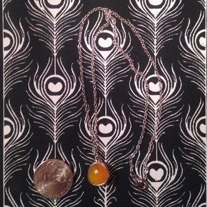 Orange pendant necklace.