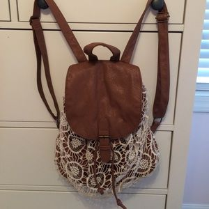 Lace and faux leather backpack