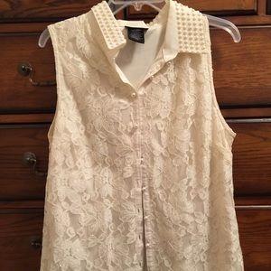 Beautiful beaded sleeveless blouse.