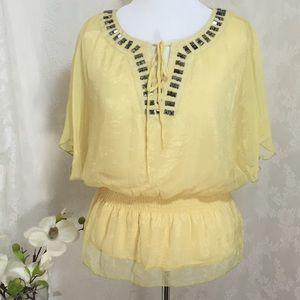 Yellow blouse with rhinestones  B004