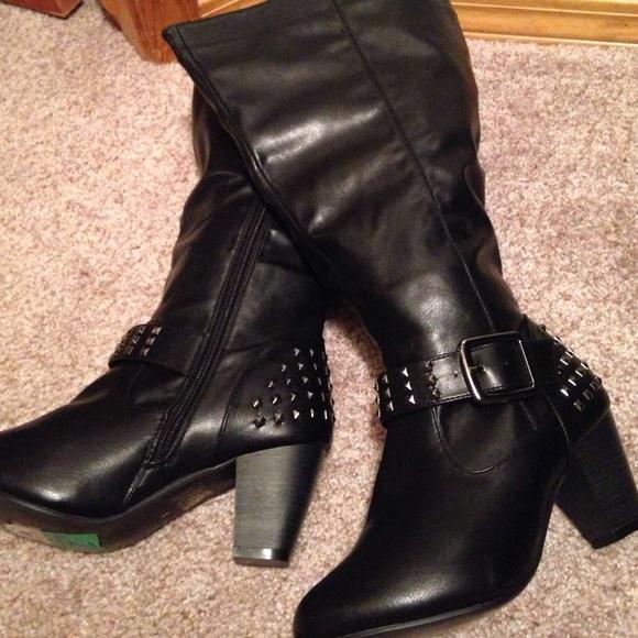 12dd17af999 Torrid Black knee high boots- wide calf   foot
