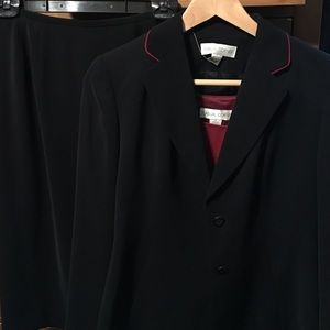 Never worn black skirt suit with red detailing.