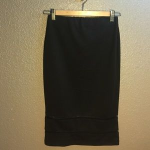 Black pencil skirt with mesh trim detail.