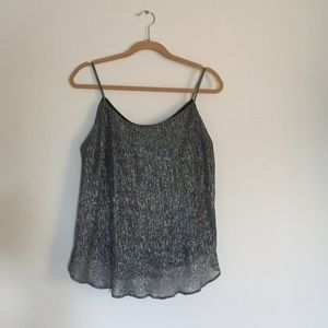 Cute shiny silver tank top. Size M. New w.o tags