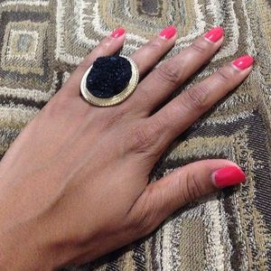 Gold ring with black rock