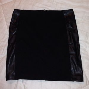 black bodycon skirt w/ leather detailing on sides