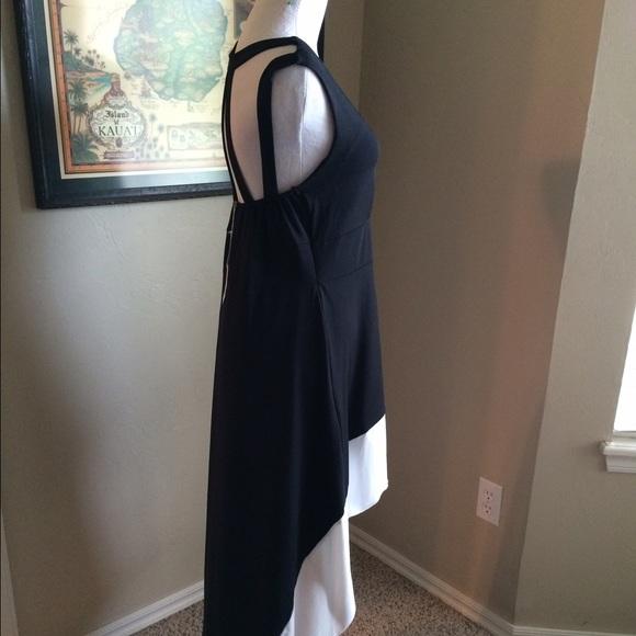 Boutique Dresses - 🎉🎉Black and white hi low dress.