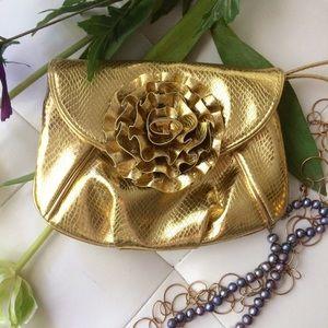 Adorable gold flower wristlet